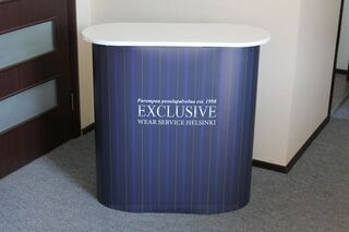 Exhibition table with companys logo